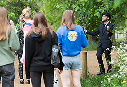 © Licensed to London News Pictures. 04/06/2021. Oxford, UK. A member of staff at Christ Church college, Oxford University stops students from entering Christchurch Meadow as they attempt to take part in an end of exam tradition known as 'trashing'. Oxford University is attempting to clamp down on the tradition which sees students throwing food, confetti and drink over their classmates. Photo credit: Ben Cawthra/LNP