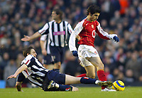 20/11/2004 - FA Barclays Premiership - Arsenal v  - West Bromich Albion - HIghbury Stadium, London<br />Arsenal's Francesc Fabregas just manages to get away from the boot of West Bromich Albion's Zoltan Gera<br />Photo:Jed Leicester/Back Page Images