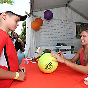 August 16, 2014, New Haven, CT:<br /> Eugenie Bouchard signs autographs in the Aetna booth during WTA All-Access Hour on day three of the 2014 Connecticut Open at the Yale University Tennis Center in New Haven, Connecticut Sunday, August 17, 2014.<br /> (Photo by Billie Weiss/Connecticut Open)
