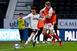 Jamie Lindsay of Rotherham United challenges Lee Buchanan of Derby County for possession - Mandatory by-line: Ryan Crockett/JMP - 16/01/2021 - FOOTBALL - Pride Park Stadium - Derby, England - Derby County v Rotherham United - Sky Bet Championship