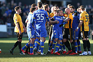 Robbie Willmott of Newport County (l) holds his shirt after he was spat on by Samual Saiz of Leeds Utd ( c no21) late in the match, leading to all the players getting involved in a scuffle and a red card for Leeds player Samual Saiz for spitting at Willmott. Emirates FA Cup , 3rd round match, Newport county v Leeds Utd at Rodney Parade in Newport, South Wales on Sunday 7th January 2018.<br /> pic by Andrew Orchard,  Andrew Orchard sports photography.