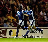 Photo: Jed Wee.<br /> Middlesbrough v Portsmouth. The Barclays Premiership. 28/08/2006.<br /> <br /> Portsmouth's Sean Davis (R) celebrates with goalscorer Benjamin Mwaruwari.