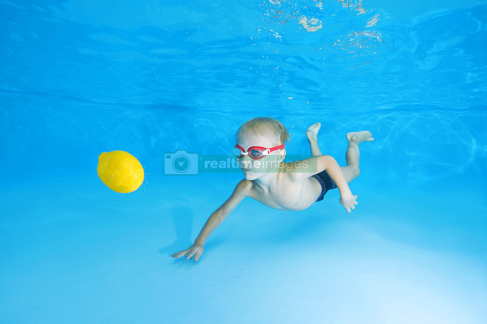 September 18, 2016 - Odessa, Ukraine - 5 years boy in a swimming goggles learning to swim underwater in the pool and looking on a floating lemon (Credit Image: © Andrey Nekrasov/ZUMA Wire/ZUMAPRESS.com)