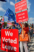 On the day that rebel Conservative Party rebels and opposition MPs attempt to pass a law designed to prevent a no-deal Brexit by the government of Prime Minister Boris Johnson, Brexiteers make their presence felt to marching pro-EU Remainers outside Parliament, on 3rd September 2019, in Westminster, London, England.