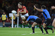 Cory Allen of Wales  gets a pass away as he's tackled by Rodrigo Silva of Uruguay. Rugby World Cup 2015 pool A match, Wales v Uruguay at the Millennium Stadium in Cardiff, South Wales  on Sunday 20th September 2015.<br /> pic by  Andrew Orchard, Andrew Orchard sports photography.