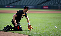 Oct 7, 2021; San Francisco, CA, USA; San Francisco Giants infielder Evan Longoria (10) takes ground balls from his knees at third base during NLDS workouts. Mandatory Credit: D. Ross Cameron-USA TODAY Sports