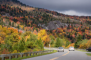 Enjoy fall foliage colors in mid October at Grandfather Mountain on the Blue Ridge Parkway in Pisgah National Forest, North Carolina, USA. This photo is from Beacon Heights Parking Area (Parkway Milepost 305.2, elevation 4220 feet) near the intersection with Hwy 221 (near Grandfather Mountain Entrance Road). Don't miss walking the Beacon Heights Trail, a half-mile round trip with 130 feet gain to a rock outcropping with vast views. The scenic 469-mile Blue Ridge Parkway was built 1935-1987 to aesthetically connect Shenandoah National Park (in Virginia) with Great Smoky Mountains National Park in North Carolina, following crestlines and the Appalachian Trail.