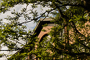 MERTHYR TYDFIL, WALES - 11 MAY 2020 - Merthyr Tydfil borough council building in the sun through the spring trees.