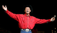 Tribune Photo/SANTIAGO FLORES Neal McCoy performed at the Morris Performing Arts Center on Monday night.
