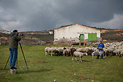 Peter Menzel, co-author of the book What I Eat: Around the World in 80 Diets, photographing sheepherder Miguel Martinez and his flock of sheep at a farm in Zarzuela de Jadraque, Spain.  (Miguel Martinez is featured in the book What I Eat: Around the World in 80 Diets.)  MODEL RELEASED.