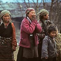 Sherpa children stare in wonder as unusual trekkers walk past them.