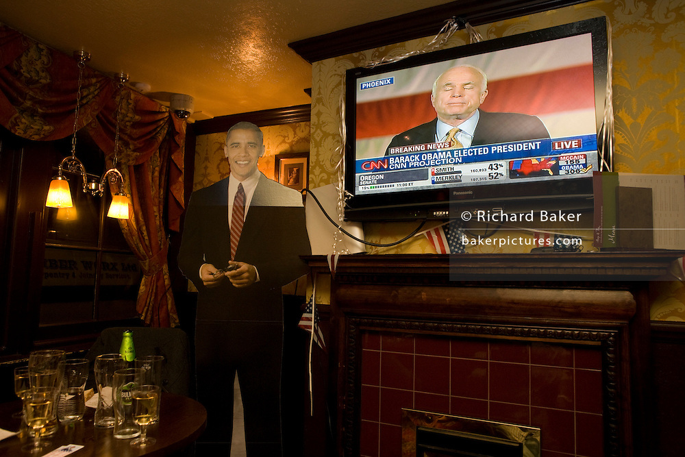 Senator John McCain concedes defeat by life-sized cut-out of Barack Obama after overnight 2008 election party in London