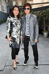 ANDY & PATTI WONG at a dinner hosted by Harper's Bazaar to celebrate Browns 40th Anniversary in aid of Women International held at The Regent Penthouses & Lofts, 16-18 Marshall Street, London on 20th May 2010.