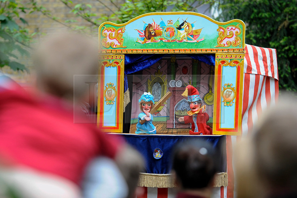 © Licensed to London News Pictures. 13/05/2018. LONDON, UK. Children watch a performance at the Covent Garden May Fayre at St Paul's Church, Bedford Street, known as the actors' church.  Now in its 43rd year, Punch and Judy professors and puppeteers celebrate the art of puppetry on Mr Punch's 356th birthday, near to where writer Samuel Pepys first saw Mr Punch in May 1662.  Photo credit: Stephen Chung/LNP