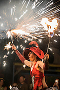 A Spanish fire performer entertains between the stages - The 2016 Glastonbury Festival, Worthy Farm, Glastonbury.