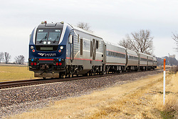Amtrak running south from Chicago to St. Louis just south of Shirley, Il.  Amtrak 4613 is a Siemens Charger,  a group of diesel-electric passenger locomotives designed and manufactured by Siemens Mobility. This model, a SC-44 was originally built for Amtrak