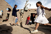 ORG XMIT: *S0423398410* (03/04/08) -- Ten of Juan's cousins play in the courtyard of their home in Loma Alta. The community is the smallest of a dozen rural settlements in Ocampo, a municipality in the state of Guanajuato. Juan bought a house here when he was 14 years old and living in Dallas. The house remains empty as he continues his schooling in the US.<br /> 06092008xNEWS 06092008xALDIA