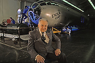 Paul E. Garber poses in front of the Enola Gay as it is being retored in the Smithsonian Air and Space facility in Silver Hill Maryland.  ..Photograph by Dennis Brack bb25