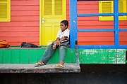 18 MARCH 2006 - SIEM REAP, SIEM REAP, CAMBODIA: A boy sits on the porch of a floating school in the floating village of Chong Khneas, at the northwest end of Tonle Sap Lake, Cambodia's vast inland sea. More than 2,500 people live on the lake in houses that move as the lake expands and contracts with the seasons. During the dry season the lake covers about 2,500 square kilometers. At the peak of the rainy season the Tonle Sap swells to more than 13,000 square kilometers. PHOTO BY JACK KURTZ