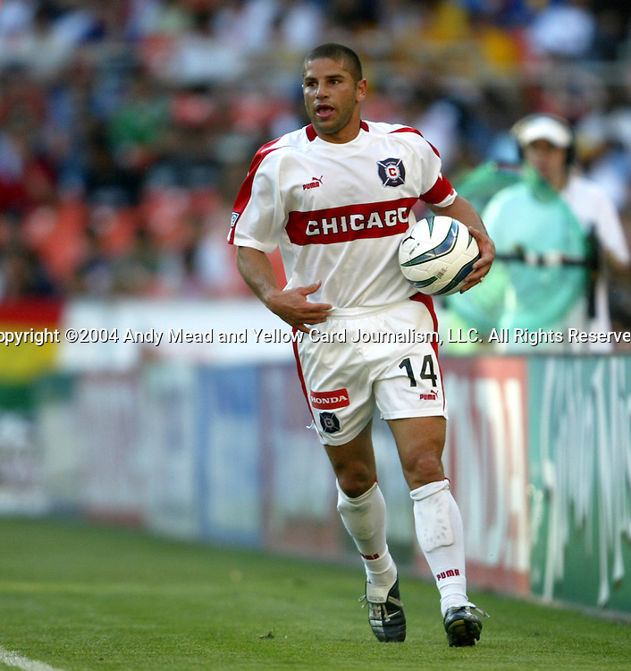 24 April 2004: Fire captain Chris Armas prepares to take a throw-in in the second half. The Chicago Fire defeated DC United 1-0 at RFK Stadium in Washington, DC on opening day of the regular season in a Major League Soccer game..
