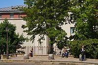 Paris , France - April 26 , 2020 :  sunbathing and social distancing in Montmartre during the  lock down coronavirus covid-19 quarantine
