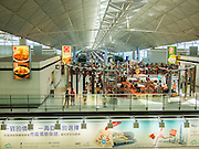 10 AUGUST 2013 - HONG KONG:    A food court in the transit area of the Hong Kong International Airport. Hong Kong is one of the two Special Administrative Regions of the People's Republic of China, Macau is the other. It is situated on China's south coast and, enclosed by the Pearl River Delta and South China Sea, it is known for its skyline and deep natural harbour. Hong Kong is one of the most densely populated areas in the world, the  population is 93.6% ethnic Chinese and 6.4% from other groups. The Han Chinese majority originate mainly from the cities of Guangzhou and Taishan in the neighbouring Guangdong province.      PHOTO BY JACK KURTZ