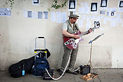 Busker on Portobello Road market, Notting Hill, West London. This famous Sunday market is when the antique stalls come out as well as the food stalls.