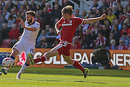 Leeds United midfielder Stuart Dallas  with a shot during the Sky Bet Championship match between Middlesbrough and Leeds United at the Riverside Stadium, Middlesbrough, England on 27 September 2015. Photo by Simon Davies.