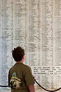 Young boy looking at the Wall of Names at the USS Arizona Memorial, Pearl Harbor, Oahu, Hawaii