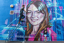 Edinburgh Science Festival, Edinburgh, Scotland, United Kingdom: <br /> Pictured: Watched by Valentina Maia, aged 6 years, graffiti and mural artist Shona Hardie puts the finishing touches to her portrait of Natalie Duffield, one of the artworks in a street art trail called 'Women in STEM' which showcases the achievements of nine women who have contributed to the world of Science, Technology, Engineering and Maths (STEM). Natalie Duffield is CEO of InTechnology SmartCitie, a company that provides free WiFi in central Edinburgh. Shona has also painted many of the other portraits in the trail which are displayed in venues across the city. <br /> The 2021 Edinburgh Science Festival runs from 26 June – 11 July.<br /> Sally Anderson   EdinburghElitemedia.co.uk