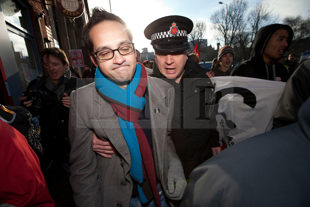 """© under license to London News Pictures. 21/2/2011: Aaron Porter, the president of the National Union of Students, is to step down following a barrage of attacks from within the student movement. At a demonstration in Manchester on 29th January 2011 police had to lead him to safety after protesters rounded on him. Photo credit should read """"Joel Goodman/London News Pictures""""."""
