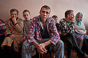 Patients in Soltanovka Adult Mental Asylum from the Mogilev region of Belarus who for a quarter of a Century have suffered the affects of the Nuclear Disaster at Chernobyl. Chernobyl's human costs are widespread affecting about seven million people. A generation later children are being born with birth defects ,heart problems and thyroid cancer.The crippled economy of Belarus has led to poverty, social problems and domestic abuse.