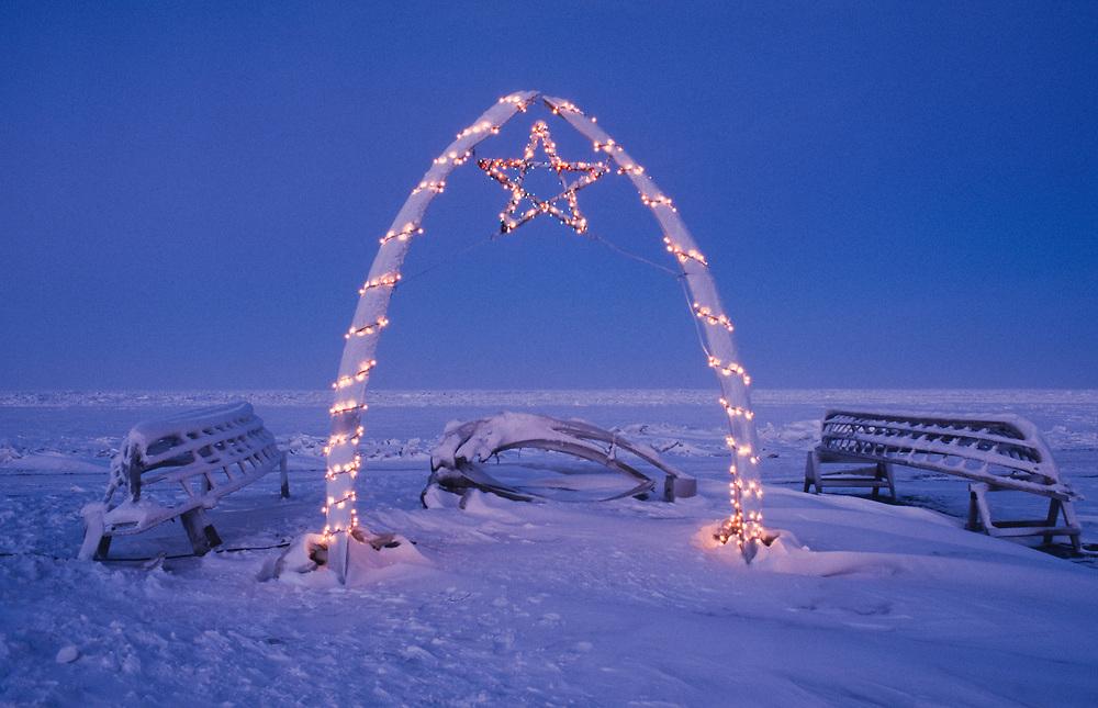 Alaska, Barrow.  Umiak (skin boat) frames and bowhead whale jaw bones on christmas.