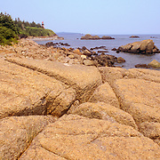 The rocky coast and lighthouse at West Qouddy Head State Park
