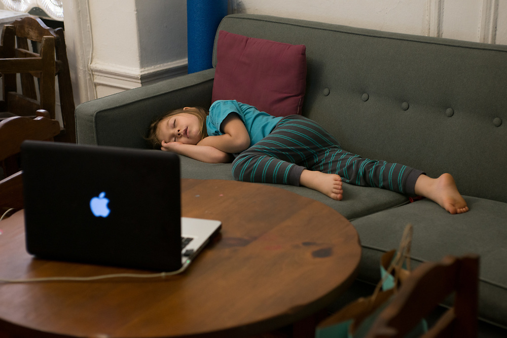 Theodore napping on the blue couch during a remote class. Neither of us can imagine what his and his classmate's minds and psyches might be going through during this time.