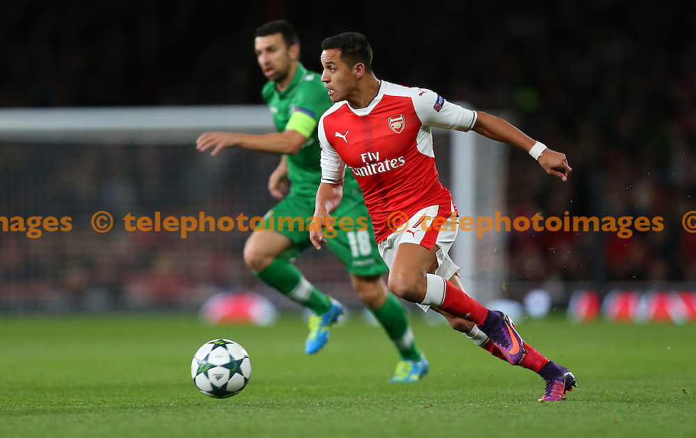Arsenal's Alexis Sanchez on the ball during the UEFA Champions League match between Arsenal and Ludogorets Razgrad at the Emirates Stadium in London. October 19, 2016.<br /> James Boardman / Telephoto Images<br /> +44 7967 642437