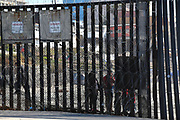 People Standing in Tijuana Mexico at the Border Wall at Imperial Beach