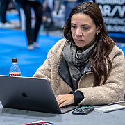 A young lady on her computer at London Tech Week at Excel London,on 12 June 2019, UK