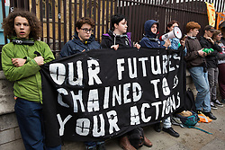 London, UK. 3 May, 2019. Climate change activists from Extinction Rebellion Youth lock onto the railings of the Houses of Parliament for three hours in the rain to call for urgent action from the British government to combat climate change, expressing disappointment regarding the outcome of talks between Extinction Rebellion representatives and Secretary of State for the Environment Michael Gove.