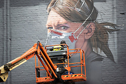 © Licensed to London News Pictures. 16/10/2020. Manchester, UK. Covid mural by artist Peter Barber for The National Portrait Gallery takes shape in Northern Quarter, Manchester. Photo credit: Kerry Elsworth/LNP