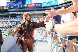 Sep 11, 2021; Morgantown, West Virginia, USA; The West Virginia Mountaineers mascot celebrates with students during the first quarter against the Long Island Sharks at Mountaineer Field at Milan Puskar Stadium. Mandatory Credit: Ben Queen-USA TODAY Sports
