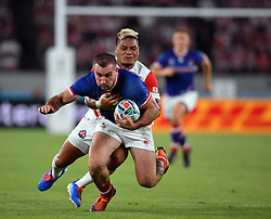 Russia's Vladimir Ostroushko is tackled by Japan's Lomano Lava Lemeki during the Pool A match between Japan and Russia at the Tokyo Stadium, Tokyo, Japan. Picture date: Friday September 20, 2019. See PA story RUGBYU Japan. Photo credit should read: Ashley Western/PA Wire. RESTRICTIONS: Editorial use only. Strictly no commercial use or association. Still image use only. Use implies acceptance of RWC 2019 T&Cs (in particular Section 5 of RWC 2019 T&Cs) at: https://bit.ly/2knOId6