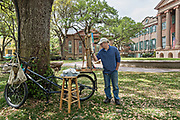 Artist David Anthony Babb known as DAB works on a painting using his dabism technique in the Cistern yard at the College of Charleston in Charleston, South Carolina.