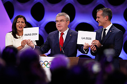 LIMA, Sept. 14, 2017  International Olympic Committee President Thomas Bach (C) passes two cards to Anne Hidalgo, Mayor of Paris, and Eric Garcetti, Mayor of Los Angeles, during the presentation and announcement ceremony of the 2024 and 2028 Summer Olympic Games at the 131st IOC session in Lima, Peru, on Sept. 13, 2017. The IOC makes historic decision by simultaneously awarding Olympic Games 2024 to Paris and 2028 to Los Angeles on wednesday. (Credit Image: © Luis Camacho/Xinhua via ZUMA Wire)