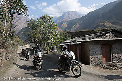 Kelly Modlin with Sean Lichter riding right behind and the Annapurna Range in the background on Day-7 of our Himalayan Heroes adventure riding from Tatopani to Pokhara, Nepal. Monday, November 12, 2018. Photography ©2018 Michael Lichter.