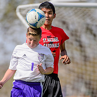 081815       Cable Hoover<br /> <br /> Miyamura Patriot Jacob Mortensen (1) knocks a header away from St. Michael Cardinal Tyree Dalgai (3) during a scrimmage at Public School Stadium in Gallup Tuesday.