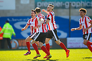 Lincoln City defender Samuel Habergham (3) scores a goal and celebrates to make the score 3-1 during the Vanarama National League match between Lincoln City and Forest Green Rovers at Sincil Bank, Lincoln, United Kingdom on 25 March 2017. Photo by Simon Davies.