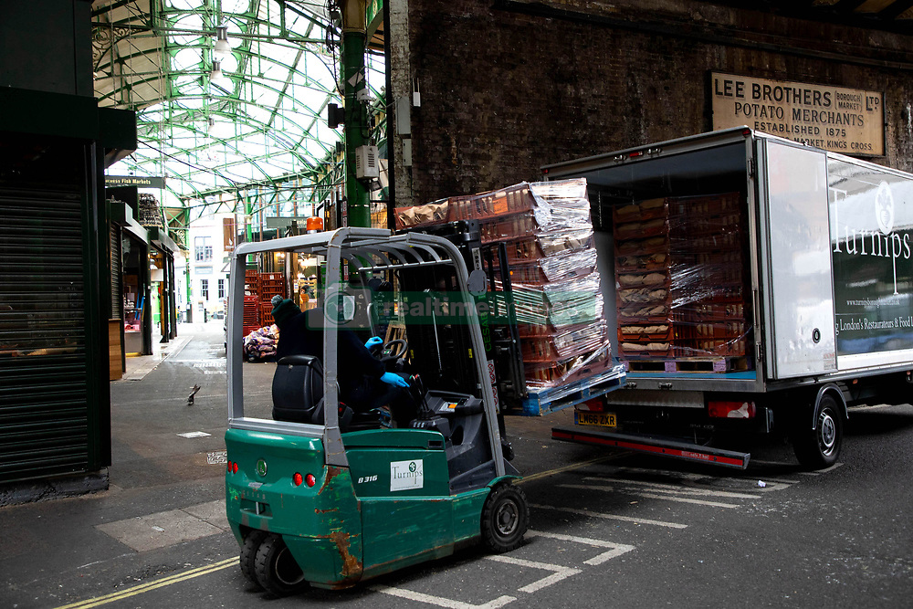 EDITORIAL USE ONLY A thousand fruit and vegetable packages destined for healthcare workers fighting the COVID-19 pandemic are loaded onto trucks as Borough Market spearheads the national 'Feed The Frontline' campaign, London.