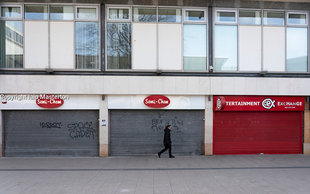 Leith, Edinburgh, Scotland, UK. 7 April 2020. In the third week of the nationwide coronavirus lockdown life in Leith continues although the streets are mostly deserted and shops closed. Pictured; Empty shuttered shops in Newkirkgate shopping arcade. Iain Masterton/Alamy Live News.