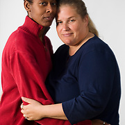 Tracey Cooper-Harris, in red , an Army veteran, is legally married in CA to Maggie. Tracey has been told that her medical benefits are not available to her same sex spouse.